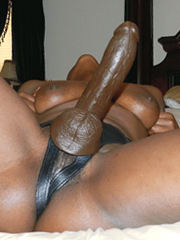 Black woman with strap on cock